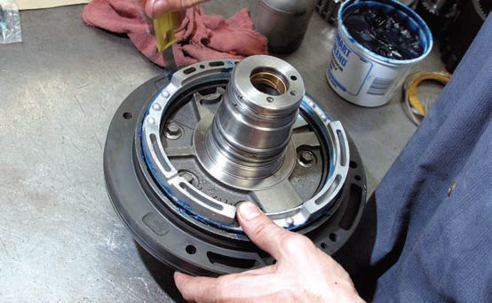 Seal installation tools take all forms. The key is to avoid damaging the seals during piston and shaft installation. Here's one approach to seal protection during clutch piston installation using an old thickness gauge.