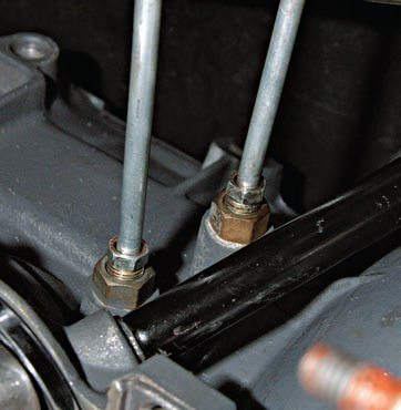 Run transmission cooler lines parallel with the engine/transmission package all the way to the radiator or transmission cooler. This eliminates any chance of leakage and is much safer.