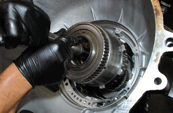 """Although many transmission builders build transmissions horizontally on a workbench, the easiest way to assemble a transmission is to """"stack build,"""" with the case standing vertically, tailshaft end down, once the tailshaft is installed."""