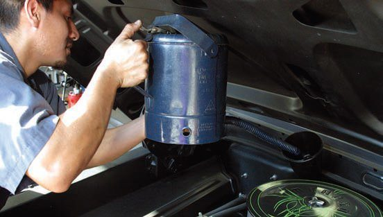 "When you add fluid for the first time, bring it up to just below normal range on the dipstick. Remember, as the transmission warms, the fluid expands. If you top off at the ""Full"" mark cold, you will have fluid all over the garage floor when the sump reaches operating temperature. Add fluid in small amounts and allow the transmission to reach operating temperature. Run the selector through all ranges and re-check the fluid level. You want fluid at the 3/4 to ""Full"" mark hot. Never add fluid above the ""Full"" mark because it will cause foaming and erratic operation."