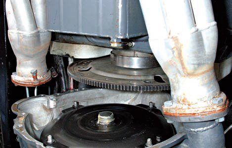 Adaptor kits use a crank spacer to move the flex-plate aft into alignment with the bellhousing and torque converter. Adaptor kits are easy to use. It can get tricky at the transmission crossmember and mount, because not all kits have a crossmember. One may have to be fabricated.