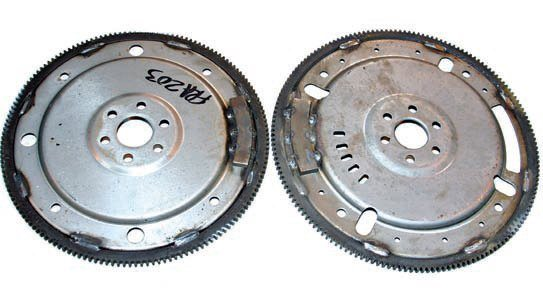Here are two small-block Ford flexplates. On the left is the 157-tooth version for the C4 Cruise-O-Matic with a 28-ounce offset balance. On the right is the larger 164-tooth flexplate for AOD, AODE, and 4R70W with a 50-ounce offset balance. Small-block Fords prior to 1982 are normally 28-ounce offset balanced. Engines from 1982-up are 50-ounce offset balanced with a larger weight welded to the flexplate. This 164-tooth flexplate is 50-ounce offset balanced with a larger weight. If you're working with an unknown engine, you have to examine the flexplate to determine the offset balance.