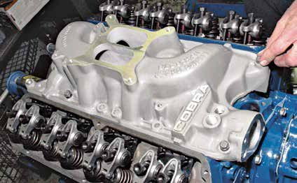 The Cobra dual-plane high-rise manifold is a popular induction swap for small-block Fords. Excellent reproductions of this manifold are available from Tony D. Branda Shelby & Mustang. The thing that makes this manifold a good swap is its ability to handle both low- to mid-range torque as well as high-RPM horsepower. Generous high-ceiling intake runners deliver both torque and horsepower.
