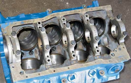 This is the Boss 302/302 Tunnel Port block, which is the only small-block Ford (Fairlane V-8) produced with four-bolt mains. The Boss 302/302 Tunnel Port block sports screw-in freeze plugs and 4.000-inch bores.