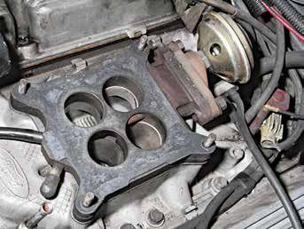This is the 1983–1985 carburetor spacer for the Holley 4180C with exhaust gas recirculation (EGR). Do not eliminate this spacer; it is important to emissions and proper engine function.