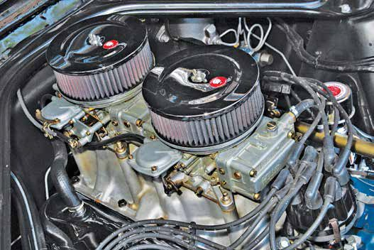 Ford offered some great multi carburetion packages over the counter at its dealers. This is the Buddy Bar high-rise dual-quad manifold (C6OA-9424-A) topped with a pair of Holley 3300-series side-pivot fuel-bowl carburetors. The primary carburetor is a Holley 3360 (C6OA-A) and the secondary carburetor is a 3361 (C6OA-B).