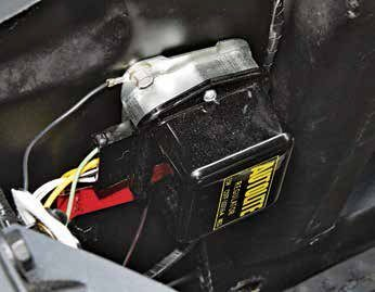The Autolite/Motorcraft 1G alternator used an external voltage regulator. The best advice is to go with an electronic voltage regulator. Contact-point regulators just don't keep a consistent charge. If you want authenticity, use a reproduction Autolite cover.