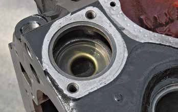 The 351C's controlled bypass flow brass insert must never be removed. This insert is crucial to proper engine cooling because it limits thermostat cycling and reduces overheating issues. The 400 and 351M had this feature cast into the block, which means there is no brass insert.