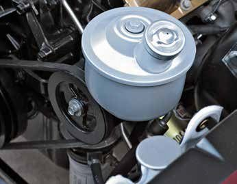 This is the Eaton power steering pump and bracket common prior to the 1965 model year, although some early 1965 model-year Fords had this pump. Some have a remote reservoir mounted at the inner fender.