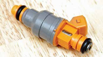 Two types of fuel injectors are common to the small-block Ford. This is the chubby Bosch EV1 injector that you see on 1986–1993 5.0L SEFI engines with a two-pin plug. The EV1 injector comes in different lbs/hr flow ratings identifiable by color.