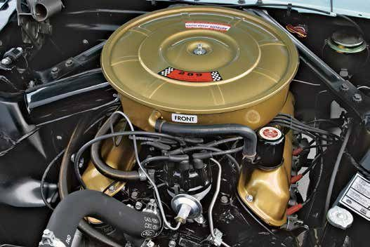 """All small-block Fords were topped with """"slope-side"""" stamped-steel valvecovers from 1962 to 1966. The earliest 221 and 260 engines didn't have an oil filler neck in the valvecover, but instead a filler tube in the timing chain cover. This is a 1965 289-4V engine with the California emissions closed crankcase ventilation filler cap."""