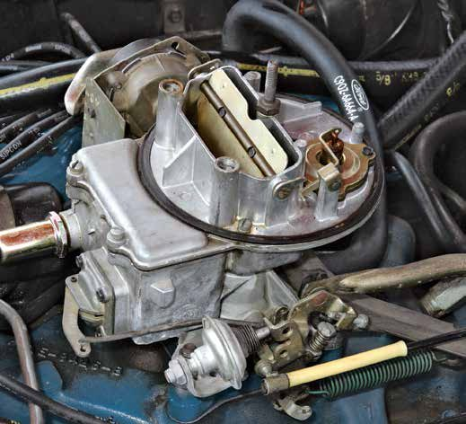 This Autolite 2100 has the closed fuel vent system and vacuum-actuated choke pull-off. The fuel bowl is vented inside the air filter where evaporative emissions are burned instead of vented to the atmosphere. The 2100 evolved with tightening emissions mandates. By 1975, it became the reduced-emissions 2150 carburetor.