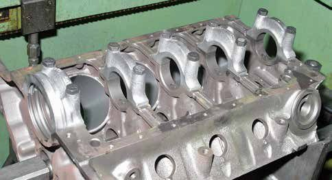 Most 221, 260, 289, and 302 blocks have these 15/16-inch-wide main caps that taper toward the casting and main cap numbers. These caps are 15/16 inch at the block mating surface and roughly 1/2 inch at the top.