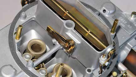 This is the hotidle compensator, which is temperature sensitive via bimetallic strips and has a valve that unseats based on engine temperature, increasing idle speed and improving stability.