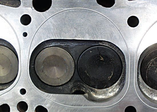 Another cylinder head modification dictated by the use of the turbocharger on this engine was a complete redesign of the standard Y-block cylinder head's combustion chambers. The addition of a turbocharger to the engine also requires custom-made pistons, as shown here. (Photo Courtesy Seppo Kokko)