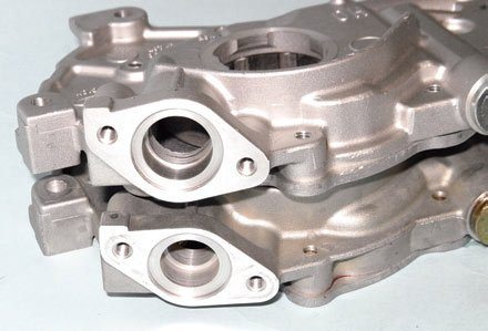 There are two basic types of oil pumps for Modular engines. The standard pump is found on all SOHC engines from the factory and delivers an adequate oil supply. The more desirable high-volume pump for the DOHC Cobra engine can be identified by its larger pick-up passage. If you want to install one on your SOHC engine, be prepared to cut the Cobra's pick-up baffle and make windage tray modifications.