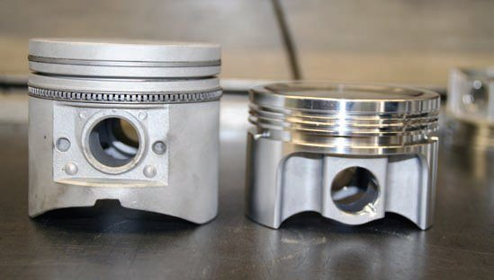 This comparison shows the difference between the customforged aluminum RaceTec (right) piston and a cast replacement (left) for the Y-block V-8.