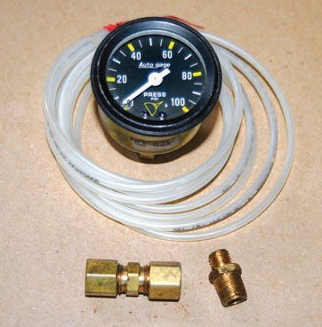 I keep an inexpensive aftermarket oil pressure gauge and an assortment of adapter fittings in my toolbox. This simple gauge has served me well over the years when working with cars that were not equipped with such a gauge from the factory or to diagnose a faulty factory gauge or sending unit.