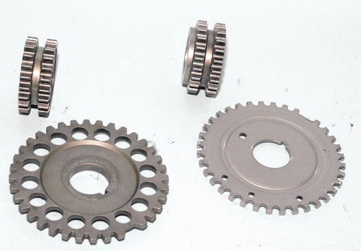 There are two types of crank sprockets. On the left is the appropriate crank sprocket for the thicker early-style reluctor wheel; it does not have the offset. On the right is the offset crank sprocket for a stamped-steel reluctor wheel, which is offset to make up for the difference in reluctor thickness. Do not get these crank sprockets and reluctor wheels mixed up. If you do, they will damage the engine. The large reluctor wheel triggers the electronic engine control via the crank sensor in the front timing cover. If your Modular engine has the stamped-steel reluctor wheel (right), the teeth must be pointed away from the engine block. If you point them toward the engine block, you will experience engine damage.