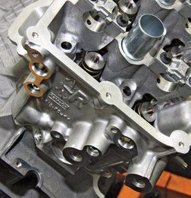 """The right-hand head has an """"R"""" and the Ford casting number. At press time, only one Coyote cylinder head exists, but two versions are available: the standard Coyote casting and the Boss 302 CNC-ported piece. Both are actually the same casting."""