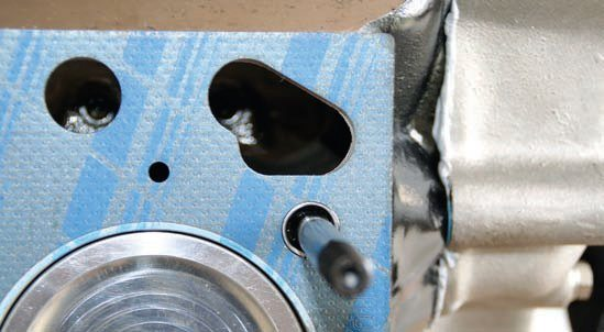 """I chose Fel-Pro Blue cylinder head gaskets to handle the sealing chores between the cylinder block and aluminum heads. The same gaskets were used in the stock rebuild. These gaskets are far superior to the OEM steel shim head gaskets originally used by Ford on Y-block engines. Again, the head gaskets only mount one way. The markings on the gaskets that read """"front"""" must face the front of the engine."""