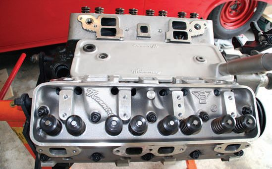 Although not lighter than the stamped OEM valley cover, this cast-aluminum piece looks great and is less likely than an OEM part to leak because of bending from overtightening. Using a proper sealant and snugging the hardware without overtightening keeps the top of the engine dry.