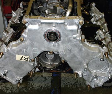 Timing cover front dress varies among vehicle types. This is a an SOHC Romeo F8ZZ-6019-CA timing cover (F6AE, F7AE, F7ZE, F8ZE-6019 casting numbers) for a 1996–1998 Mustang GT SOHC engine.