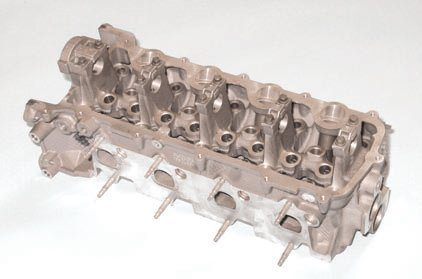 The 4.6L/5.4L SOHC threevalve cylinder head, at first glance, looks like a two-valve Windsor head with its individual cam journals, yet it's a Romeo casting. Unlike the two-valve head, this head is driver- and passenger-side specific, not omni-directional. The three-valve head provides improved airflow and significant power gain. Power comes from the use of two intake valves, liberal ports, and good exhaust scavenging. This head can be installed on any Modular block as long as you complement it with a complete induction system, exhaust components, valvetrain, and cam covers.