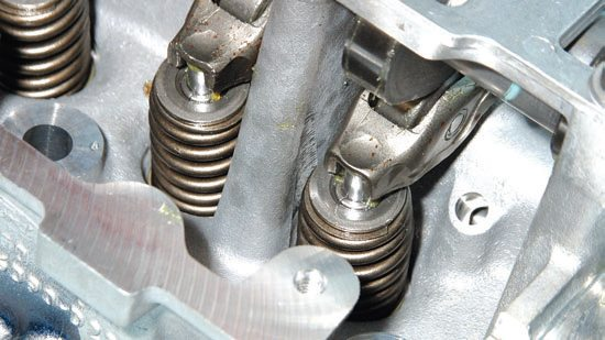Composite cam lobes hug stamped steel 1.8:1-ratio roller rocker arms, which minimizes internal friction. You may not believe this, but these factory roller rockers accommodate 10,000 rpm. Despite this claim, I suggest good aftermarket billet roller rockers if you intend to spin your Modular engine above 7,000.