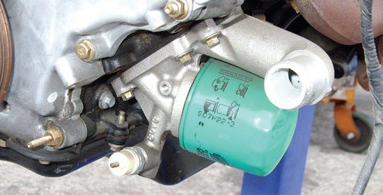 Oil filter/water neck attachments vary according to vehicle application. This is a typical 4.6L SOHC passenger car oil filter/water neck for cars without oil-to-water cooling. Oil-to-water cooling is more common on trucks and large SUVs. It is also standard on the Mustang Cobras with 32-valve power.