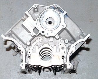 This is the 2001–up WAP block head-on. Note the absence of core plugs as you find with SOHC iron blocks. It also features the interference-fit main caps with four-bolt construction. Four-bolt main caps plus a cross-bolted design provide solid support.