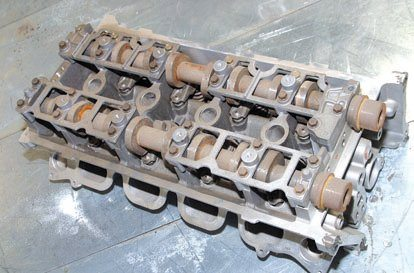 The 5.4L DOHC Tumble-Port head is virtually identical in appearance to the 1999–up Tumble-Port 4.6L Cobra head with single 170-cc intake ports. Think of the Tumble-Port as the PI DOHC head. This is an excellent cylinder head and castings are plentiful. You need a compatible induction system for this head if you're replacing the Twin-Port head.