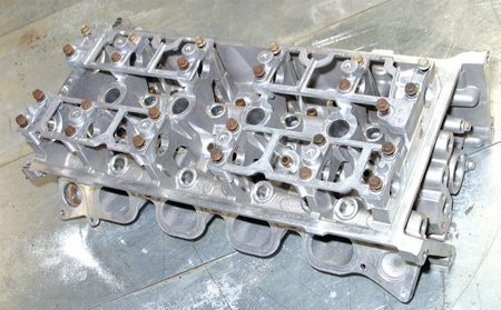 The 2003–2004 Cobra and Mach 1 DOHC head has greater flow thanks primarily to improved intake ports. Note the more open fourvalve chamber. This head is widely available and good for substantial power gains.