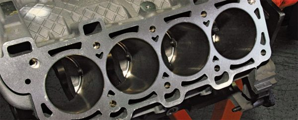 Bore spacing is the same as on the 4.6L and 5.4L blocks. However, bore size is larger via iron sleeves pressed into the aluminum block. In addition, the 5.0L embraces vastly improved cooling to handle higher compression and extreme performance duty. Notice the generous cooling passages. This block was engineered for the toughest racing conditions.