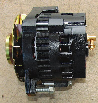 One example of a cost-effective way to upgrade your original alternator is this PowerStar model made for Painless Performance by Powermaster. It's a direct bolt-in for the factory part yet has much higher output, especially at lower RPM where you need it the most if you add things such as an electric cooling fan. The single-wire design of the PowerStar alternator along with its internal voltage regulator may require some minor adaptations. If you use the single-wire feature (the alternator automatically activates above a given RPM), life is simple: just run a suitable wire from the alternator output to the battery. It also allows you to adjust the output voltage and has a V-belt pulley for compatibility (serpentine is also available).