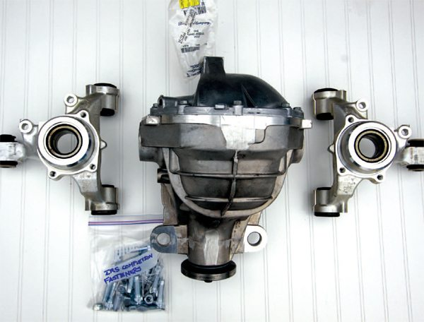For this stage of assembly, you need the IRS hub carriers, center section, completion package, components, torque wrench, marker, snap-ring pliers, 3/8-, 3/4-, and 15/16-inch sockets, ratchet, 3.25 pints of gear oil, and 4 ounces of friction modifier.