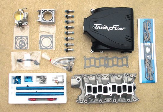 This assortment of aftermarket upgrades can replace their respective standard 5.0L components. The Trick Flow Specialties (TFS) Track Heat intake manifold is similar to the OEM manifold but has been revised to flow much better in the 1,500- to 6,500-rpm range while providing even more balanced distribution to each port. The higher-flow (36 lbs/hr) TFS TFX injectors provide significantly better response and atomization compared to stock injectors. Using the basic EEC-IV control system with various component upgrades gives the benefit of a proven OEM system with more and better features, which is also scalable for higher power and is ultimately very cost-effective because you change the system very little as you make more modifications.