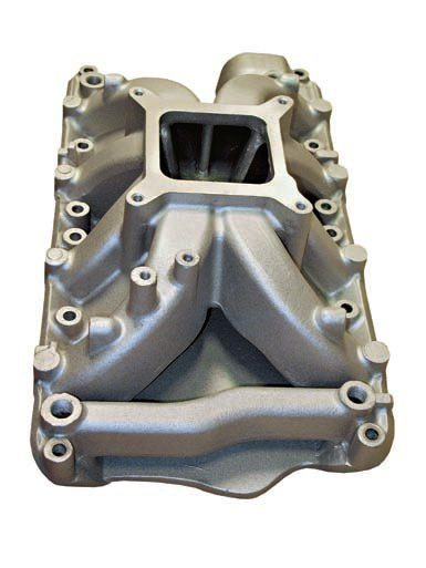 A rear crossover passage on the intake manifold, as shown on this Summit Racing Stage IV part, can improve cooling. It helps ensure more balanced cooling between the cylinder heads. Even with the most-precise water pump and engine block designs, a flow imbalance as the coolant rises from the block through the heads is not uncommon. The crossover helps ensure both heads consistently receive a similar amount of flow and cooling.