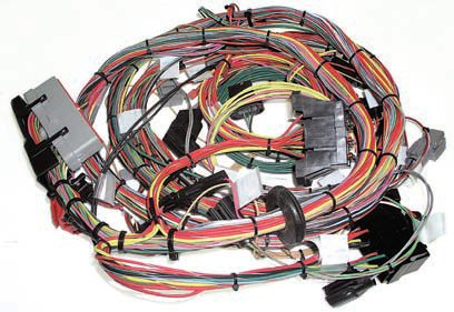 A new high-quality EEC-IV wiring harness from companies, such as Ron Francis Wiring or Painless Performance is necessary. They use superior more-modern materials, which provide better durability and connectivity. These aftermarket harnesses can often be bought in special configurations made for use in older vehicles. In this photo you can clearly see the labels/tags used to identify individual circuits. The color coding and looming of the wiring is also more simplified. (Photo Courtesy Painless Performance)