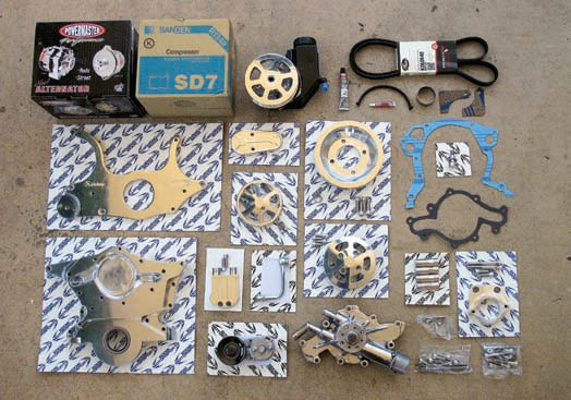 This S.Drive serpentine-belt conversion kit from Eddie Motorsports comes with everything you need to eliminate your old V-belt system and upgrade to the newer, better serpentine design. It includes a new Powermaster alternator, a compact and efficient Sanden A/C compressor, a Unisteer/Mavel Saginaw-type power steering pump, and a short-profile Ford Motorsports water pump. Besides allowing the engine to be shorter, the use of a tensioner and idlers provide much greater belt stability. It also needs less total tension so there's less strain and wear on bearings.