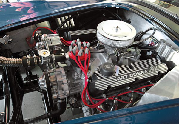 On the QMP Racing Engines engine dynamometer, our 427 Dart Manufacturing aluminum block V-8 engine topped with Dart pro-CNC aluminum cylinder heads made 516.7 hp and 492 ft-lbs of torque. Original Cobras had aluminum bodywork and cast-iron engines. Ours has fiberglass and aluminum bodywork and an all-aluminum engine. Hence, our Factory Five Racing Mk4 Cobra roadster replica should have a significantly lower curb weight. What's more, the engine produces almost 100 more hp than the 427 cast-iron lumps of yore.