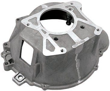 Newer OD transmissions, such as the T-5 or the TKO, require the use of a different bellhousing than older transmissions. Adapter plates allow you to reuse the original bellhousing with the new transmission but are not preferable, especially with higher power levels. New OEM parts are a better fit, are very lightweight, and often have a cast-in boss (below the window for the clutch fork) to mount a clutch release cable, thus facilitating the conversion from an older mechanical linkage. (Photo Courtesy Tremec)