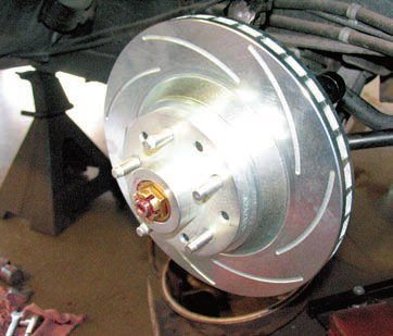 When mounting the rotors it's critical that the wheel bearing preload be property set. The kit manufacturer generally provides the necessary information for this. Some general guidelines are that the rotor spins freely and smoothly, there is virtually no visible play or movement if the rotor is rocked back and forth (with hands grasping the rotor 180 degrees apart and moving in opposite directions), and the slots (if any) are positioned correctly (the inner/leading edge of the slot contacting the pad first).