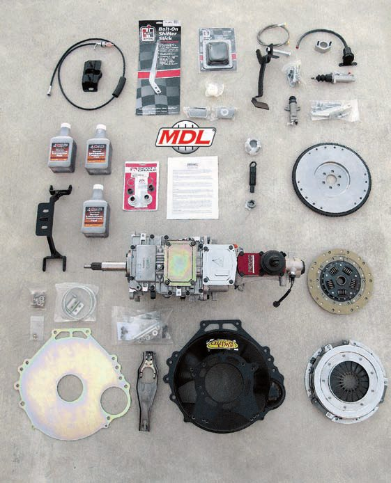 This Modern Driveline kit is for installing a Tremec TKO 5-speed manual transmission into a 1967 or 1968 Mustang. It includes the transmission, bellhousing clutch setup, hydraulic clutch actuator conversion kit, new transmission crossmember and mount, shift handle and related accessories, speedometer cable and gear, synthetic transmission fluid and, in this case, a complete pedal setup with roller bearing upgrade to convert a car that originally had an automatic transmission.