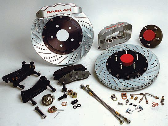 """The Baer Pro Plus system is suitable for a street/track car. It comes with """"only"""" 13- or 14-inch two-piece rotors with all the essentials: 1-inch-thick, vented, enhanced internal cooling vanes, drilled, slotted, plated, etc. The 6P calipers are six pistons in a staggered arrangement to minimize pad taper, machined billet two-piece body with stainless steel pistons and hardware, dual DOTcompliant seals, and a choice of three standard colors or the custom color of your choice. Braided steel lines and special hubs are also included. The ExtremePlus with a 14- or 15-inch rotor and a 6S one-piece forged monoblock caliper is usable on the street but it's more of a racing system. The cost and capabilities aren't easily justified for street use. (Photo Courtesy Baer Racing)"""
