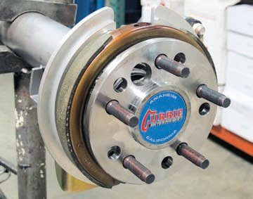 Here the brake shoe has been installed. The clearance to the axle flange must be sufficient to compensate for the lateral movement of the axle under hard cornering. This is particularly true with C-clip-style axles (such as in the 8.8-inch)