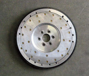 The most significant means for improving engine response is the use of an aluminum flywheel. This results in a very dramatic reduction in weight and rotational inertia. This flywheel features a replaceable steel friction surface to provide acceptable durability and wear.