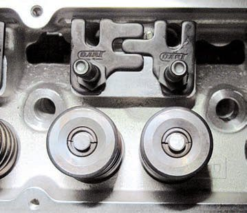 Comp Cams, Dart, and others offer stud-mounted rocker arm hardened guideplates to help improve valvetrain stability. These from Dart Machine are used to keep the pushrods properly located relative to the rocker arms. The plates restrict the lateral movement of the similarly hardened rocker arms. These Dart plates are unique in that they're adjustable to allow precise and independent centering of each pushrod under its respective rocker arm.