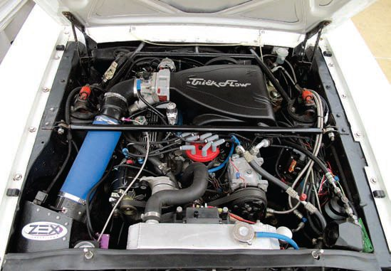 Even with long-tube headers there was no need to modify the shock towers on this 5.0L-based 347 stroker in a 1965 fastback; it was an easy fit. This engine has many other modifications and puts out more than 400 hp at the wheels (well over 500 rwhp when the ZEX nitrous system is on) yet still has exceptional performance, driveability, and fuel economy. This engine uses the OEM EEC-IV fuel injection system plus a programmable Abaco MAFS to simplify tuning. It also sports aftermarket A/C and many other modifications yet is reliable and easy to work on. (Photo Courtesy Coast High Performance)