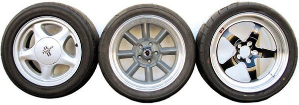 This side-by-side comparison gives you an idea of the differences in wheel diameter versus sidewall height. These tires do not have the exact same overall diameter but they're pretty close. The way they look on the car is what matters and the later, larger cars can use a larger-diameter wheel because of their larger wheelwells and because the large wheel is more proportionally correct for their size. They also need a wider tire, which is easier to accommodate with the larger rim. When wheel diameter and/or width is increased significantly you should upgrade the brakes to fill the visual gap and to compensate for the increased rotational inertia (and braking distance) of larger-diameter wheel/ tire combinations.